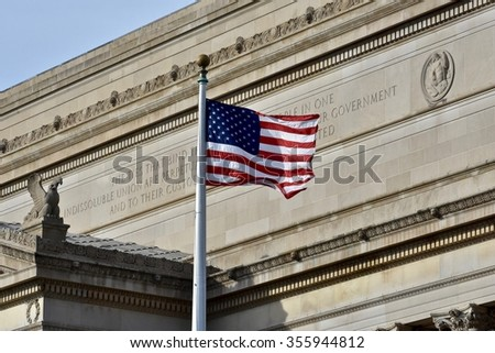 WASHINGTON DC, USA - DECEMBER 28, 2015: American flag in front of a historic building at the National Mall. The National Mall is a national park in downtown Washington, D.C. - stock photo