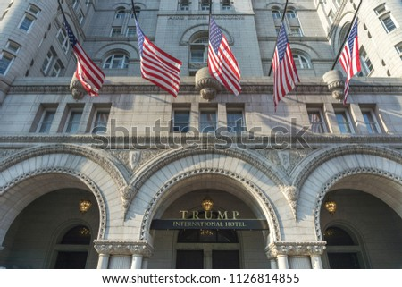 Washington, DC / USA - July 4, 2018: Flags fly at half staff at the Trump International hotel in Washington, DC after the latest mass shooting.