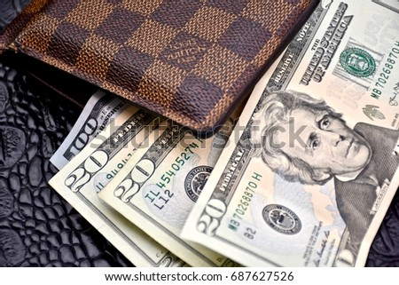 WASHINGTON DC, USA - JULY 31, 2017: Louis Vuitton mens wallet with United States cash.