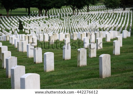 Washington DC, USA - May 31, 2016: Many people visit cemeteries and memorials, particularly to honor those who have died in military service. The gravestones at Arlington National Cemetery.