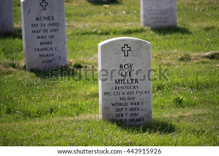 Washington DC, USA - May 31, 2016: Many people visit cemeteries and memorials, particularly to honor those who have died in service. The gravestones  are decorated by U.S. flags on Memorial Day. - stock photo