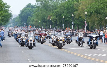WASHINGTON, DC, USA - MAY 29: Motorcycles travel down Constitution Avenue as part of the annual Rolling Thunder motorcycle ride for American POWs and MIA soldiers on May 29, 2011 in Washington, DC, USA - stock photo