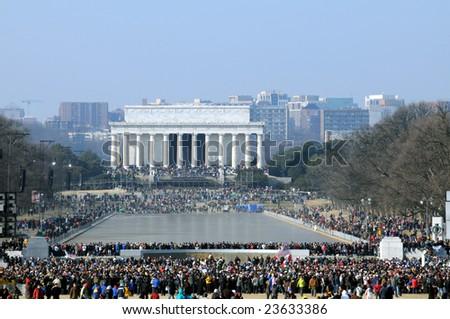 WASHINGTON - JAN 20: Record crowds attend the inauguration of U.S. President Barack Obama on January 20, 2009 in Washington. - stock photo