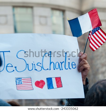 WASHINGTON - JANUARY 11: A sign held during a silent protest against the terror attacks in Paris in Washington, DC on January 11, 2015