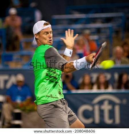 WASHINGTON - JULY 29: Lleyton Hewitt defeats fellow Australian Marinko Matosevic during the Citi Open tennis tournament on July 29, 2014 in Washington DC - stock photo