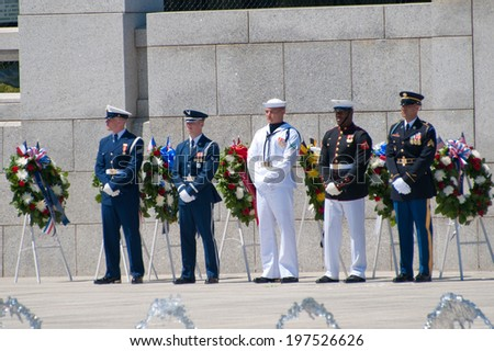 WASHINGTON JUNE 6:  The branches of the military are represented during the ceremony marking the 70th anniversary of DDay at the WWII Memorial June 6, 2014 in Washington, DC - stock photo