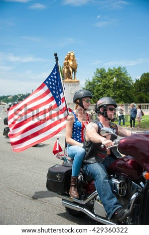 WASHINGTON MAY 29: A rider takes part in Rolling Thunder, a motorcycle rally to bring attention to POWs and MIAs of US-involved wars, on May 29, 2016 in Washington, DC.   - stock photo