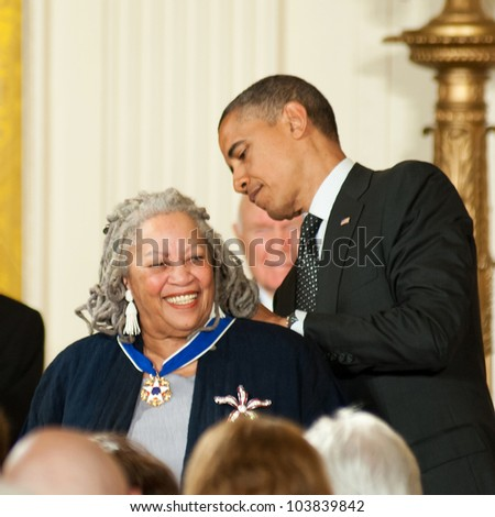 WASHINGTON - MAY 29: Novelist Toni Morrison smiles as she is presented with a Presidential Medal of Freedom at a ceremony at the White House May 29, 2012 in Washington, D.C. - stock photo