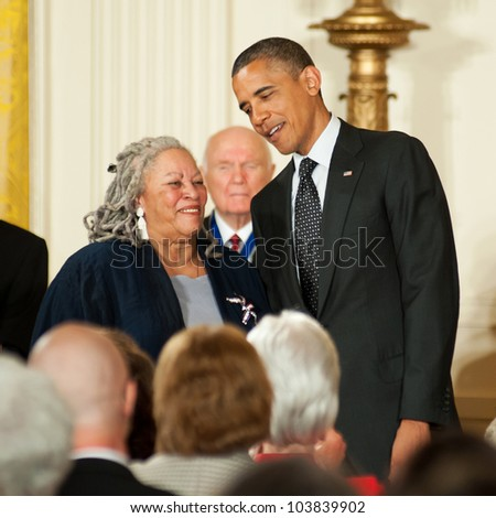 WASHINGTON - MAY 29: Novelist Toni Morrison smiles as she stands with President Obama before receiving the Presidential Medal of Freedom at a ceremony at the White House May 29, 2012 in Washington, D.C. - stock photo