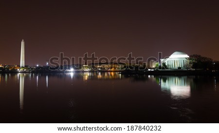 Washington Monument and Jefferson Memorial at night with city skyline on background. Colorful reflections of Washington landmarks in Tidal Basin. - stock photo