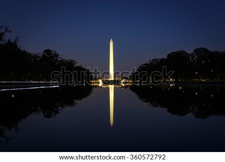 Washington Monument illuminated at night with reflection - stock photo