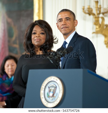 Washington -Â?Â? November 20: Oprah Winfrey waits to receive the Presidential Medal of Freedom at a ceremony at The White House on November 20, 2013 in Washington, DC.  - stock photo