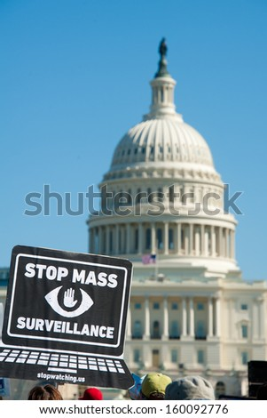 WASHINGTON - OCTOBER 26: Protesters rally against mass surveillance during an event organized by the group Stop Watching Us in Washington, DC on October 26, 2013. - stock photo