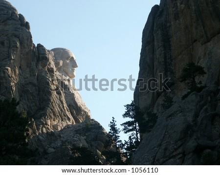 Washington Presidential Profile - profile of President Washington at early sunrise, Mount Rushmore. - stock photo