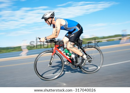 WASHINGTON - SEPTEMBER 13: An athlete cycles in the Nation's Triathlon on September 13, 2015 in Washington, D.C.