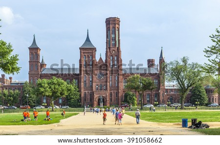 WASHINGTON, USA - JULY 14, 2010: Smithsonian Castle in Washington DC,USA . People from all over the world come to visit the Smithsonian Castle.