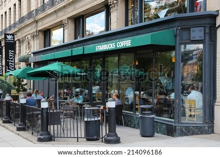 WASHINGTON, USA - JUNE 14, 2013: People relax at Starbucks Coffee in Washington, DC. Starbucks is the largest coffee house company in the world, it has 20,891 stores in 62 countries. - stock photo