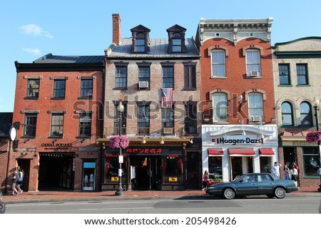 WASHINGTON, USA - JUNE 14, 2013: People visit shops in Georgetown in Washington, DC, USA. Georgetown Historic District belongs to U.S. National Register of Historic Places. - stock photo