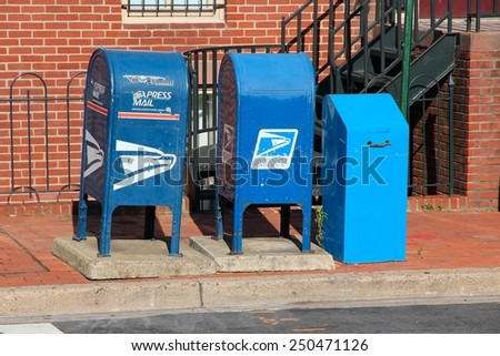 WASHINGTON, USA - JUNE 14, 2013: United States Postal Service mail boxes in Washington DC. USPS employs 626,764 people. - stock photo