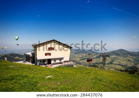 WASSERAUEN, SWITZERLAND - June 4, 2015: Summit station of the Ebenalp cableway in Switzerland, a very popular starting point for paragliders at 5,400 feet above sea level. - stock photo