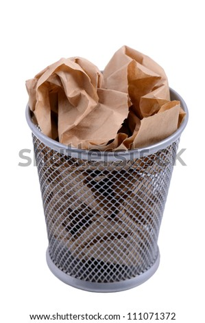 waste bin with crumpled brown paper - stock photo