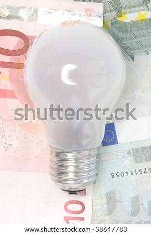 waste of energy and money...old lightbulb - stock photo