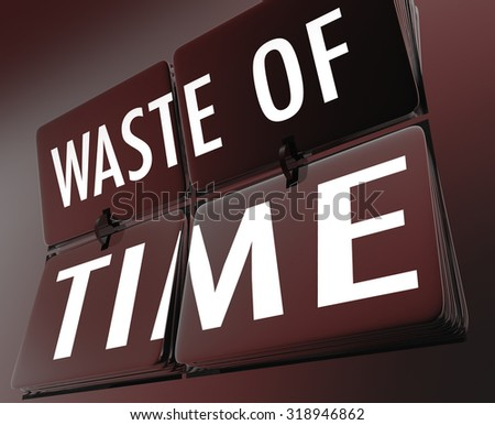 Waste of Time words on flipping clock tiles to illustrate inefficient working habits and lost efforts due to ineffective procedures or just screwing around - stock photo