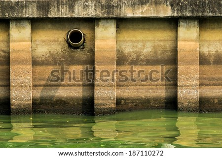 waste pipe or drainage polluting environment, concrete pipe. - stock photo