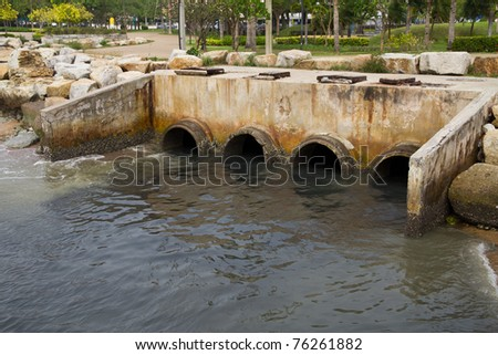 waste pipe or drainage polluting environment, concrete pipe - stock photo