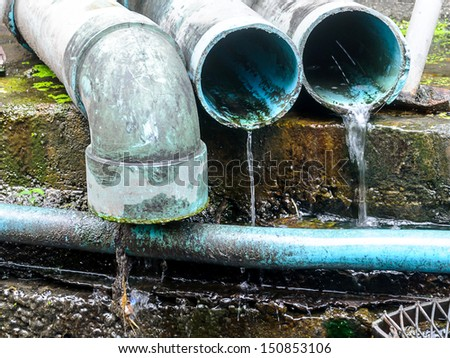 Waste pipe or drainage polluting environment, PVC pipe.  - stock photo
