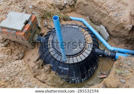 Waste treatment tank / septic tank installation - stock photo