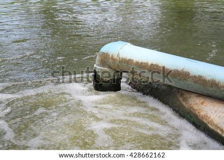 Waste water flow from water pipe - stock photo