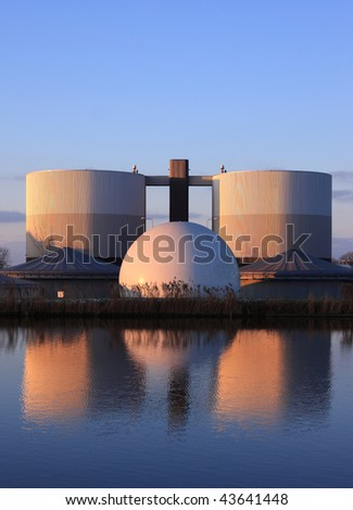 Waste water purification plant in late sun. - stock photo