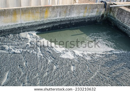 waste water treatment with biological mud pool - stock photo