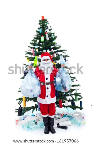 Wasted christmas - environment concept with santa and plastic bottles decorated tree - stock photo