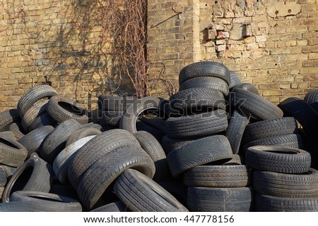 wasted tires in fron of brick wall