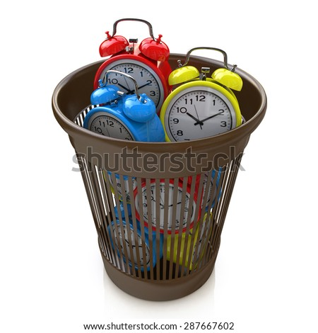 Wasting time concept: alarm clocks in the trash bin  - stock photo