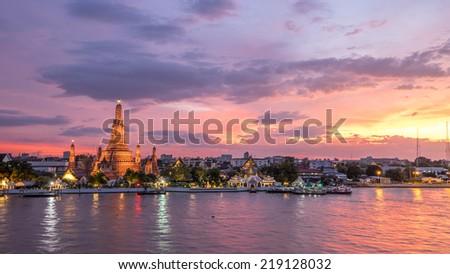 Wat Arun along Chao Phraya River during sunset in Bangkok, Thailand - stock photo