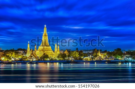 Wat arun and light from boat with blue sky , Thailand - stock photo
