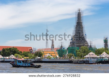 Wat Arun Buddhist religious places of importance in the repair process, Bangkok, Thailand - stock photo