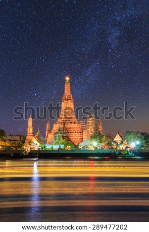 Wat Arun Buddhist religious places under milky way stars and space dust in the night sky, Bangkok, Thailand - stock photo