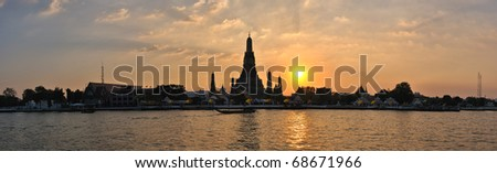 Wat Arun Thailand Temple in panorama sunset scene - stock photo