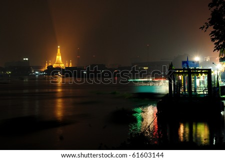 Wat Arun, The Temple of Dawn, at night, view from pier Siriraj Hospital, Bangkok, Thailand. - stock photo