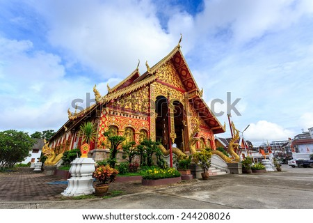 Wat Chet Yod temple in Chiang Rai at sunny day - stock photo