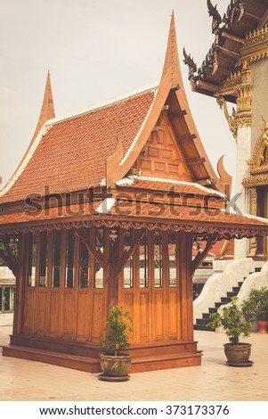 Wat Intharawihan buddhist temple in Bangkok holds the tallest standing buddha in the world. - stock photo