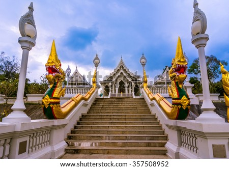 Wat Kaew temple in Krabi, Thailand. Wat Kaew: one of the main temples (to some it may look like a shiny white wedding cake) located on Thanon Maharat close to Th. Pattana.