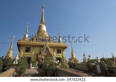 Wat Khiri Wong, The beautiful big golden temple in Nakhonsawan, Thailand. - stock photo