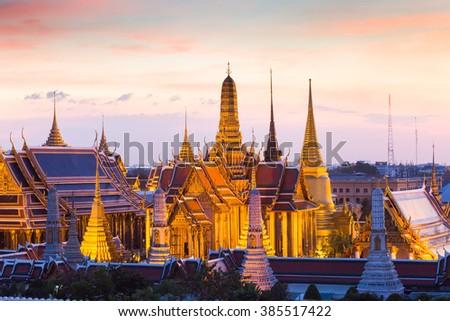 Wat Phra Kaew, temple of the emerald Buddha and Grand Palace at twilight in Bangkok, Thailand - stock photo
