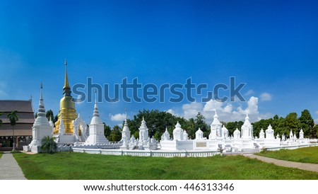 Wat Suan Dok at Chiangmai, Thailand in the sunlight, capture through the tree. - stock photo