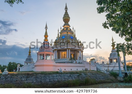 Wat Thung Saet Thee Beautiful modern pagoda reflection with water during sunset twilight time at Khon Kaen, Thailand.